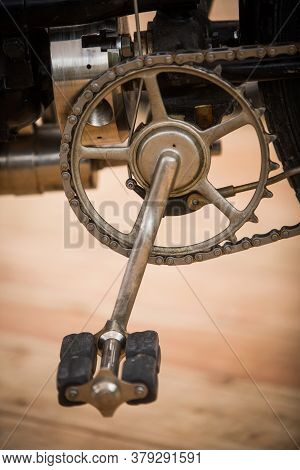 Close Up Shot Of A Very Old Motorcycle Pedals And Chain.