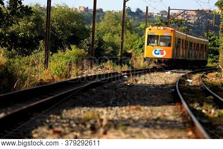 Salvador, Bahia / Brazil - November 23, 2015: Suburban Train Is Seen Passing Through The Lobato Neig