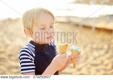 Preschooler Boy Eating Ice Cream On Hot Summer Day On Beach During Family Holiday.gelato Is Loved De