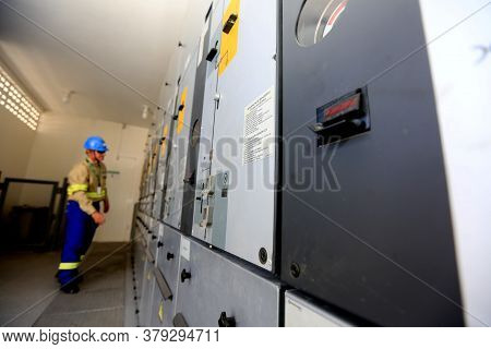 Lauro De Freitas, Bahia / Brazil - August 10, 2016: Technician Observes Electrical Panels In Coelba