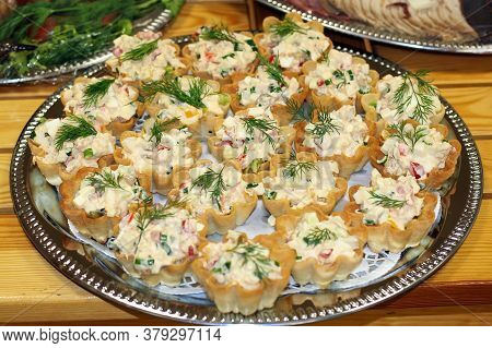 Tartlets On An Iron Tray, Which Stands On A Wooden Table.