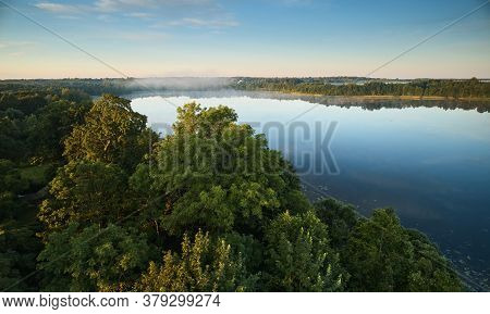 Misty Lake In Sunrise Time
