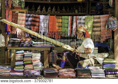 Bagan/myanmar-october 4th 2019: Long Necked Karen, A Native Of Myanmar, Is Weaving For Sale As Souve