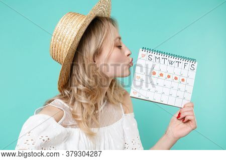 Close Up Of Woman In Hat Kissing Periods Calendar For Checking Menstruation Days Isolated On Blue Tu