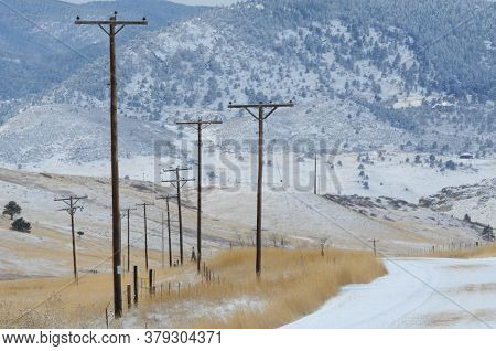 Rural Colorado Mountain Telephone Poles By Side Of The Road During Snow Storm
