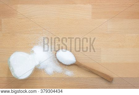 White Sugar In Wood Spoon And Sugar Jar On Wooden Background With Copy Space