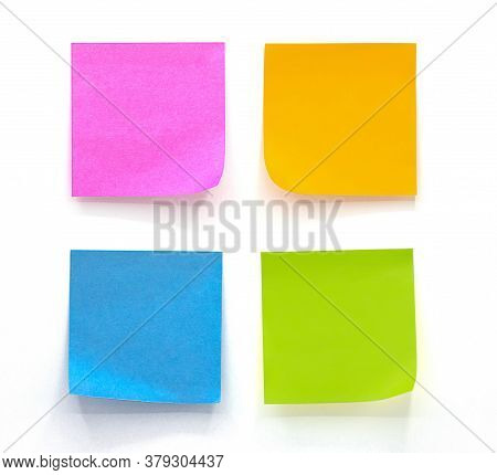 Collection Of Different Colored Sheets Of Note Papers Isolated On White Background