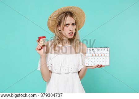 Worried Woman In Hat Hold Periods Calendar For Checking Menstruation Days Medication Tablets, Aspiri