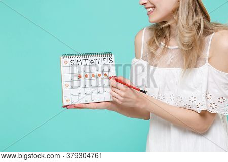 Cropped Image Of Young Woman Girl In White Dress Hold Periods Calendar For Checking Menstruation Day