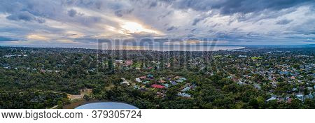 Aerial Panorama Of Mornington Peninsula On A Cloudy Day At Sunset. Suburban Area With Trees And Port