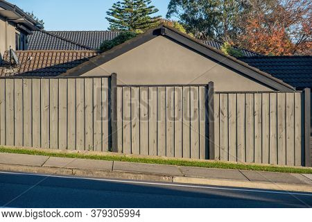 Slanted Street With Fence And House Behind It In Australia