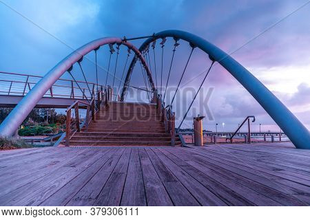 Low Angle View Of Beautiful Footbridge In Frankston Foreshore At Sunset. Melbourne, Australia
