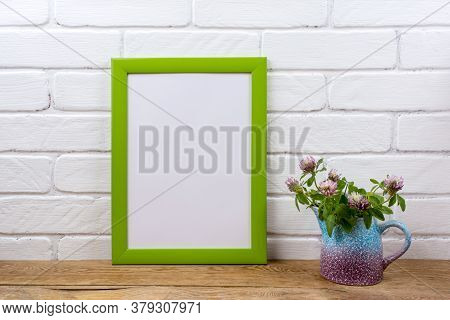 Green Poster Frame Mockup With Pink Clover In Pitcher