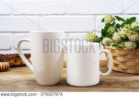 White Coffee And Cappuccino Mug Mockup With White Spirea