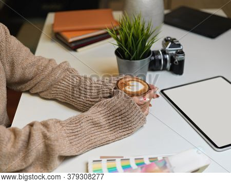 Female Holding A Cup Of Beverage On Office Desk With Digital Tablet, Clipping Path.