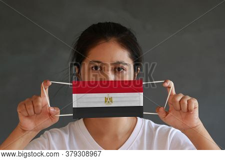 A Woman In White Shirt With Egypt Flag On Hygienic Mask In Her Hand And Lifted Up The Front Face On