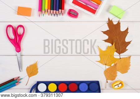 Frame Of Office Accessories And Orange Leaves On White Boards, Copy Space For Text Or Inscription, B