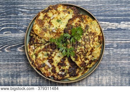 Zucchini Pancakes With Herbs Is A National Dish In Ukraine. Fresh Zucchini Pancakes In A Plate, Clos