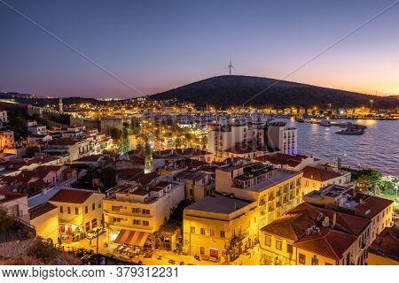 Cesme cityscape at Aegean sea coast at night, Turkey