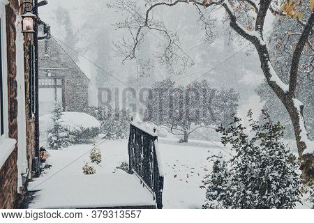 A Snow Covered Entryway To A Large Suburban Home During A Snow Storm