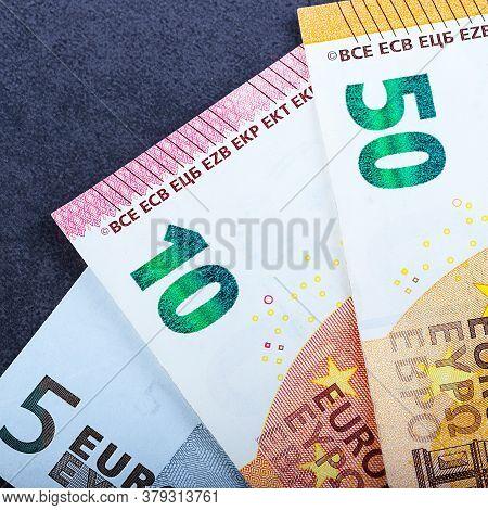 Euro Cash On A Blue Background. Euro Money Banknotes. Euro Money.