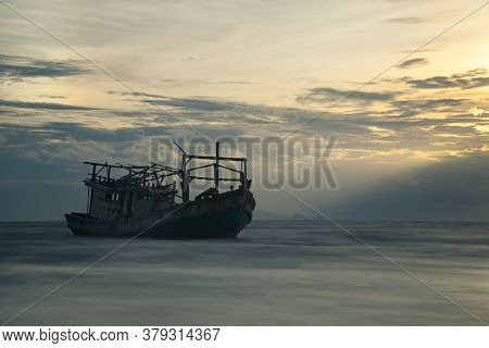The Scenery Of The Long-exposure Of The Shipwreck In Sunset Time At Samui Island, Surat Thani Provin