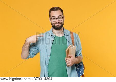 Smirked Young Man Student In Casual Clothes Glasses Backpack Hold Books Isolated On Yellow Backgroun