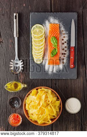 Pappardelle Pasta With Salmon. Italian Traditional Cuisine. Ready Dish On A Wooden Table