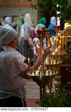 Belarus, The City Of Gomil, April 8, 2018. City Church. Orthodox Easter.woman In A Church By Candlel