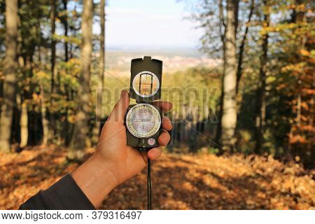 Autumn Travel.tourism And Hiking In The Fall Season. Walk In The Autumn Forest. Compass In A Man's H
