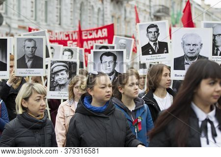 Belarus, The City Of Gomil, May 9, 2019. Victory Day. Immortal Regiment. People With Portraits Of Re