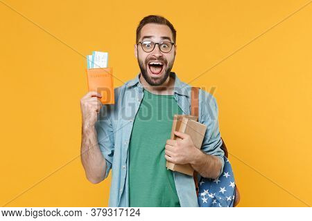 Excited Young Man Student In Casual Clothes Glasses Backpack Hold Books Passport Boarding Pass Ticke