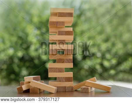 Tower Of Wooden Blocks On A Wooden Table. The Concept Of Building A Business Or Building A Team. Cop