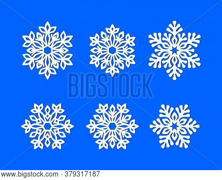 Set Of White Openwork Snowflakes On A Blue Background. Vector Silhouette, Design Template For Holida