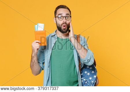 Shocked Young Man Student In Glasses Backpack Hold Books Isolated On Yellow Wall Background. Educati