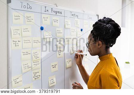 African American Woman Writing Kanban Plan On Board