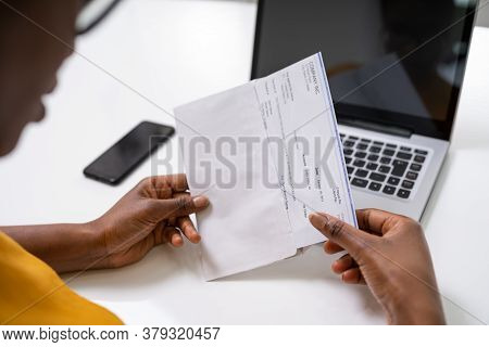 American African Holding Paycheck Or Payroll Check