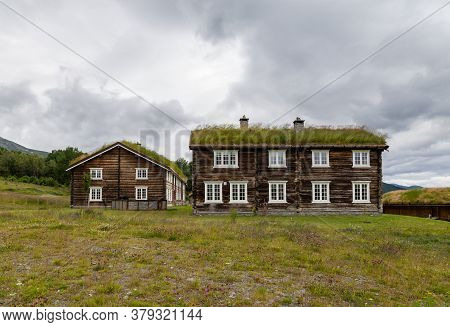 Traditional Wooden Houses With Roof Covered With Grass, Plants And Flowers In Oppdal In Norway, Scan