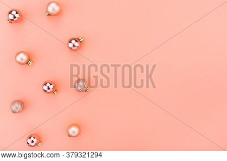 Beautiful Christmas Holiday Decorations In Contemporary Trendy Orange Colors On Coral Background.  F