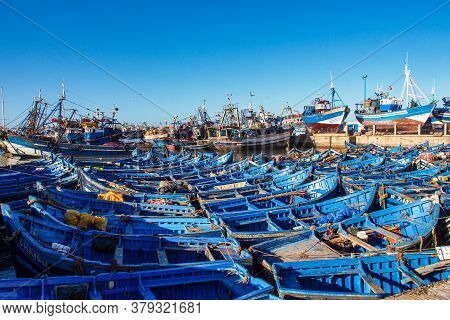 Essaouira, Morocco - Oct 24, 2019: Lots Of Blue Fishing Boats In The Port Of Essaouira, Morocco In A