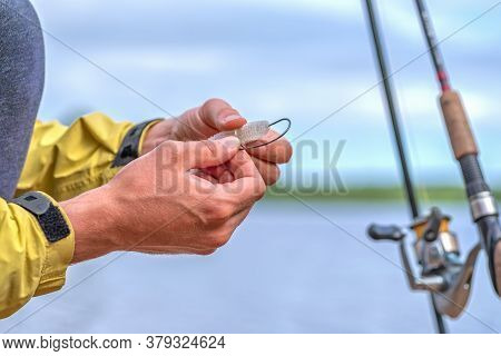 The Process Of Putting The Bait On The Hook