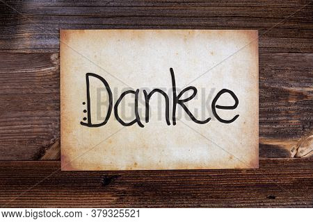 Old Paper, Danke Means Thank You, Wooden Background