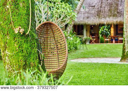 Beach swing egg chair at Mahe, Seychelles