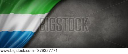 Sierra Leone Flag On Concrete Wall. Horizontal Panoramic Banner. 3d Illustration