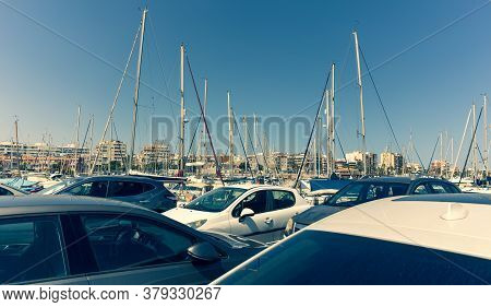 Lagoon With Yachts At The Pier In The Southern Mediterranean City. In The Foreground There Is A Park