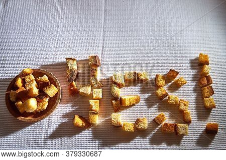 Word Yes Made From Square Toasted Pieces Of Homemade Delicious Rusk, Hardtack, Dryasdust, Zwieback O