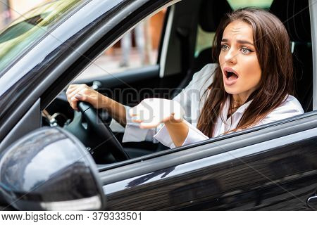 Beautiful Angry Woman Honking In Her Car While Driving On The Street