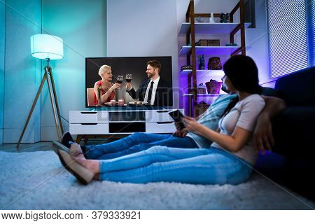 Family Watching Tv Through Tablet Television And Movie Streaming