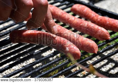 Close-up Of Grilled Sausages On Wire Rack/ Grilled Sausage With The Addition Of Herbs And Vegetables