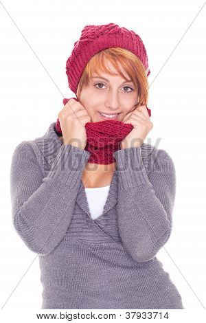 woman with scarf and cap on a winter day